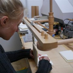 Martje sewing a bookblock, preparing for the Crafts fair